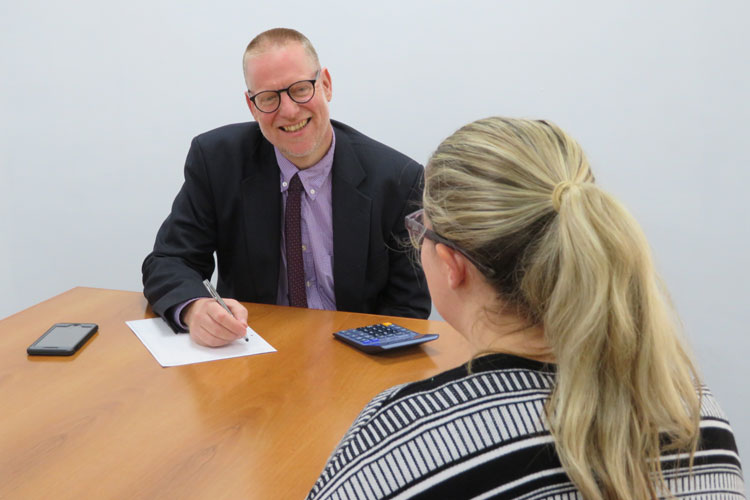 Bruce Roberts advising a business client in Wrexham